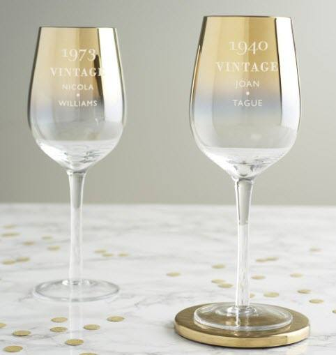 Two wine glasses with an unusual golden hue