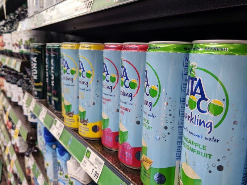 A grocery store shelf with a selection of sparkling Vita Coco coconut water
