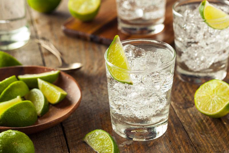 Multiple glasses of vodka soda with slices of lime