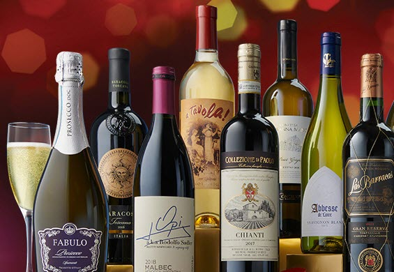 A selection of wine bottles against a red background
