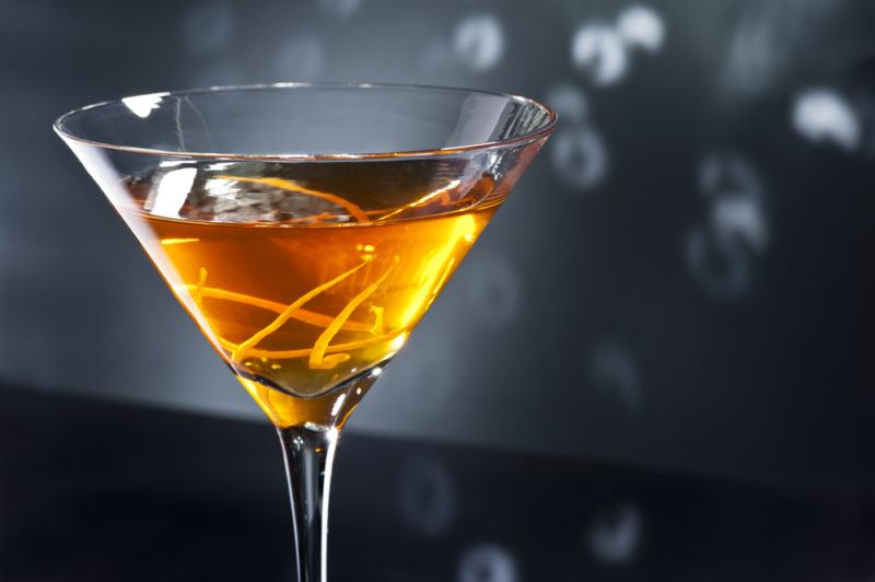 A Waldorf cocktail in a cocktail glass against a gray background