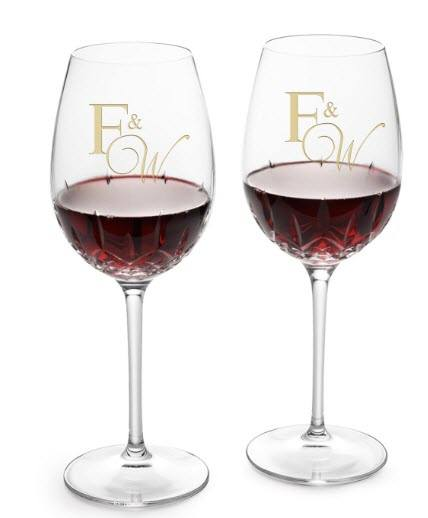 Two goblets of red wine with golden engraving.