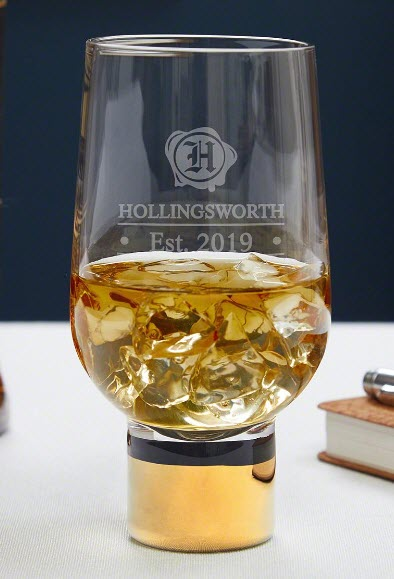 A whiskey glass with a gold base