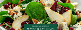 A salad with greens, pears, cheese and assorted other ingredients