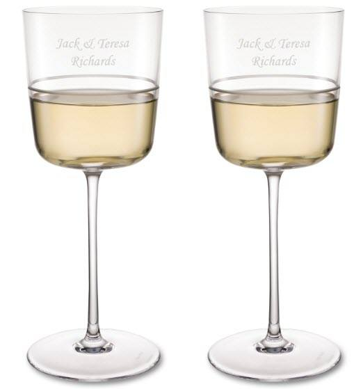 Two white wine glasses with a band and engraving