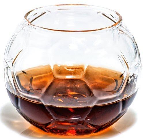 A whiskey glass shaped like a soccer ball
