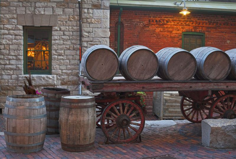 Whiskey barrels on a cart, suggesting the idea of Candian whiskey