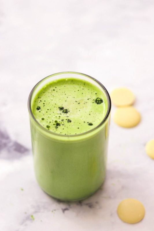 A matcha latte in a glass