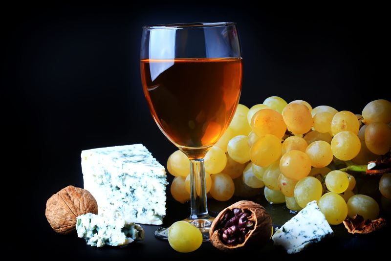 White Dessert Wine featured with Grapes Blue Cheese and Walnuts