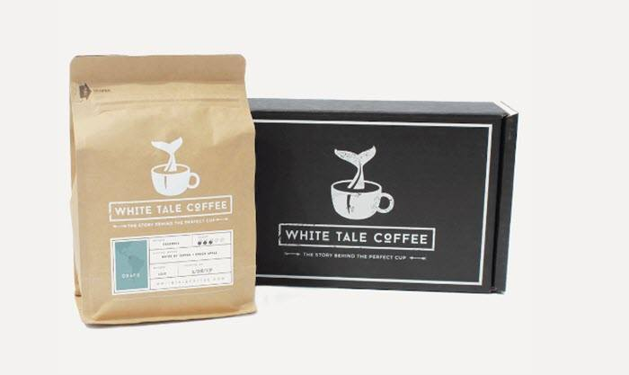 A black box with a bag of coffee