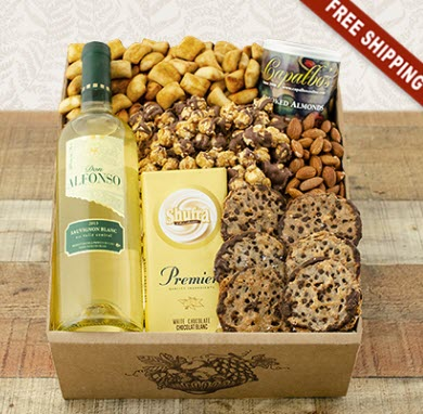 A cardboard box with white wine and snacks