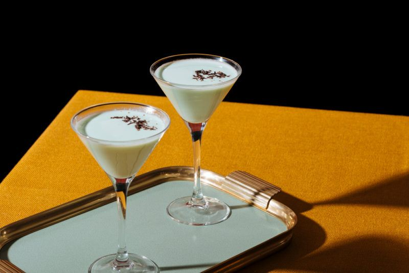 Two white chocolate grasshopper cocktails on a tray