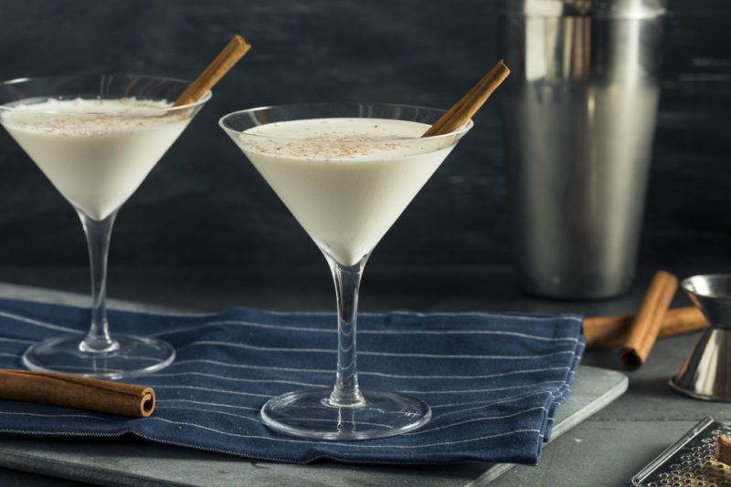 Two white chocolate martinis on a table