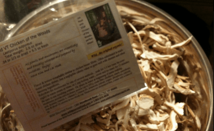 A container of dried mushrooms from Wild VT with an information card
