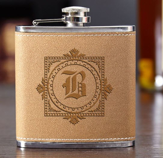 Pale brown flask with an elaborate engraving