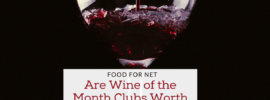 A glass of red wine against a black background