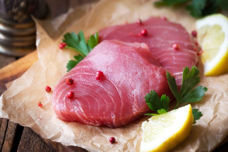 Raw yellowfin tuna on paper