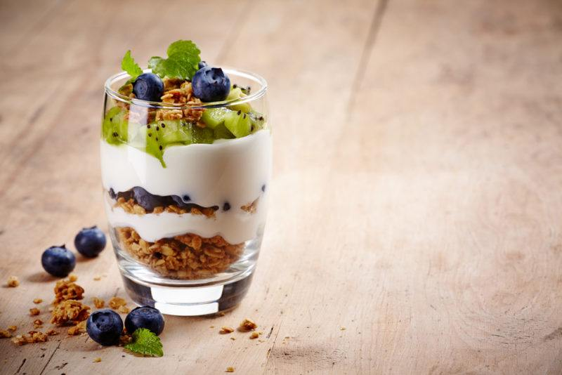 A yogurt parfait with berries and granola