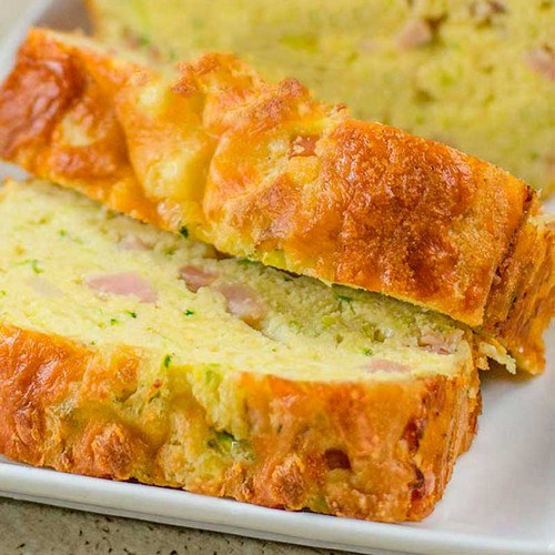 A loaf of sliced cheese and ham bread