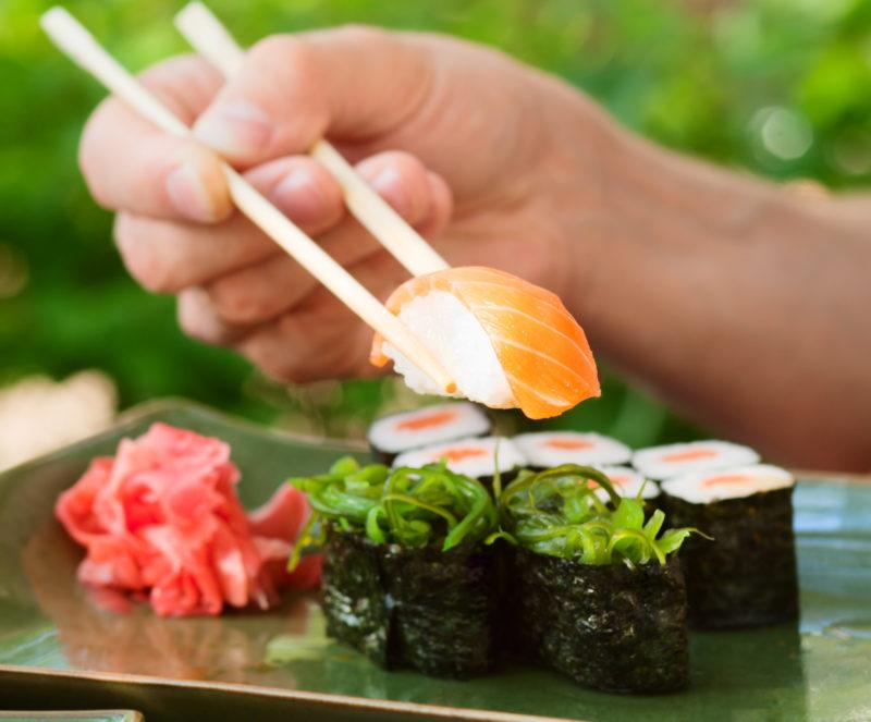 Salmon sushi and chopsticks