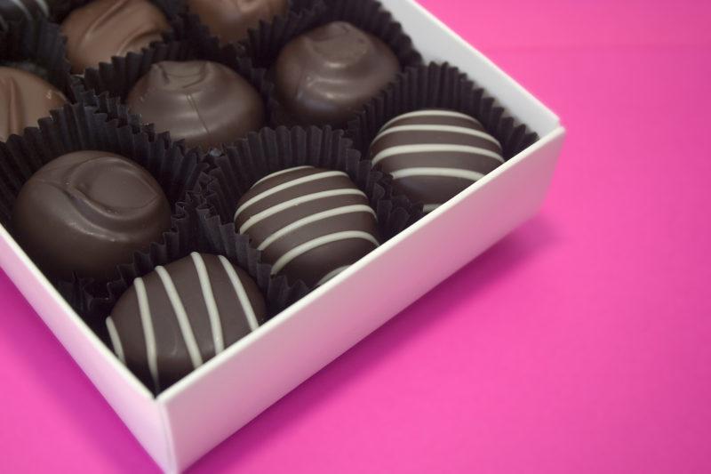 an assortment of chocolate truffles inside a box.
