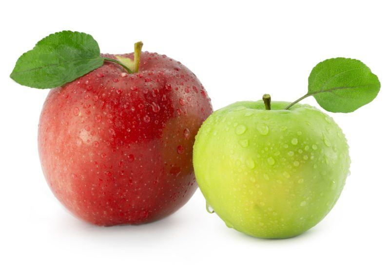 one red apple, and one green apple on a white background