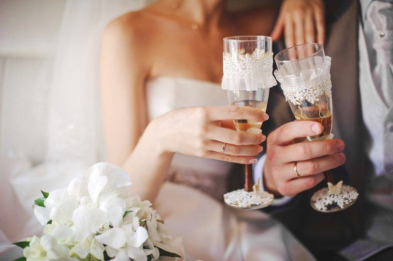 Wedding glasses and a bride and groom