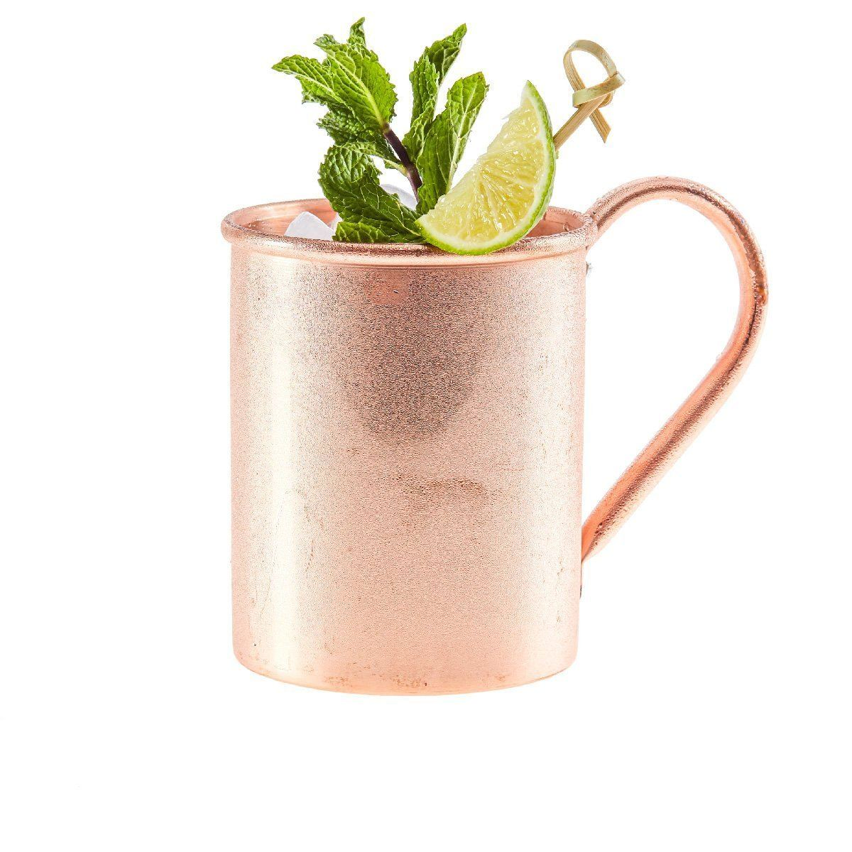 Copper mug with a moscow mule garnished with mint and lime