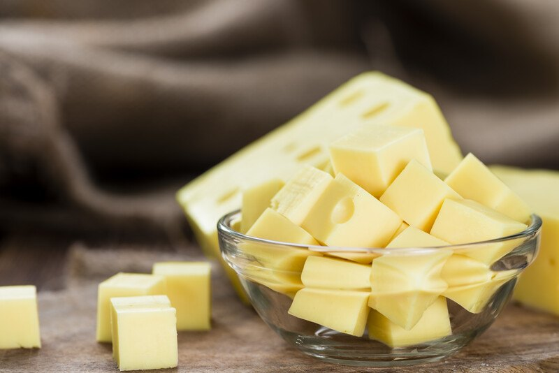 a closeup image of a clear glass full of cubed cheese