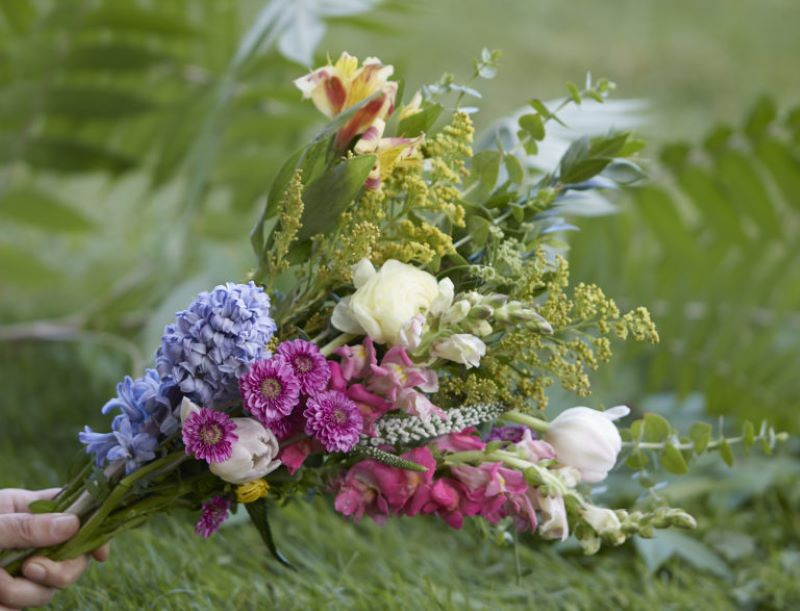 Beautiful soft colored wild flower bouquet in someone's hand