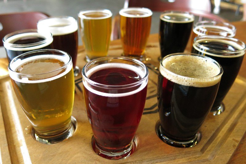 flight of mixed styles of craft beer