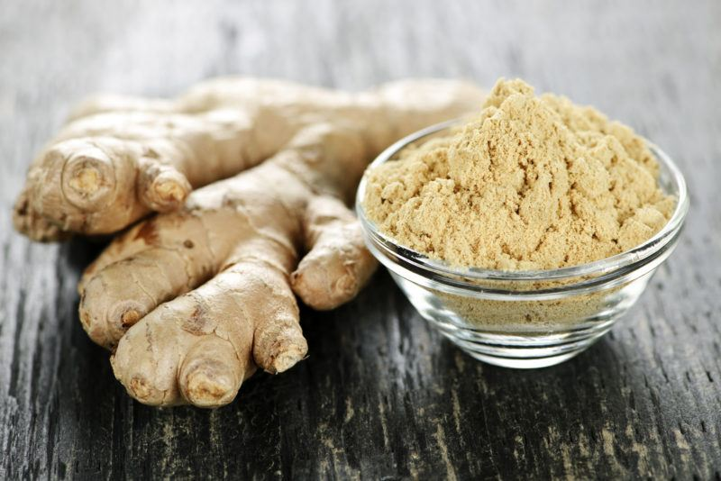 fresh ginger and freshly-grated ginger on a glass bowl