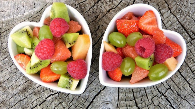 assorted fruits in two heart shaped bowls to represent fruit delivery services