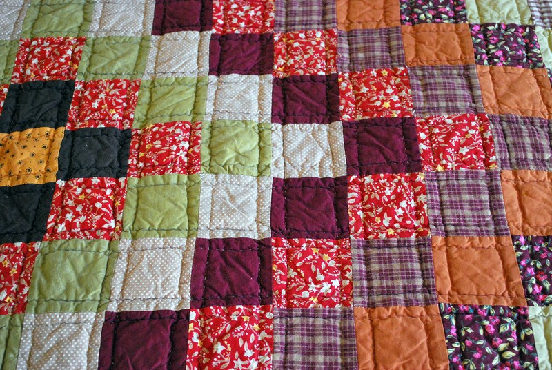 Handmade quilt with variety of colorful blocks and various design