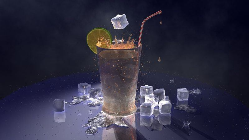 a drink surrounded by ice cubes to represent ice delivery services