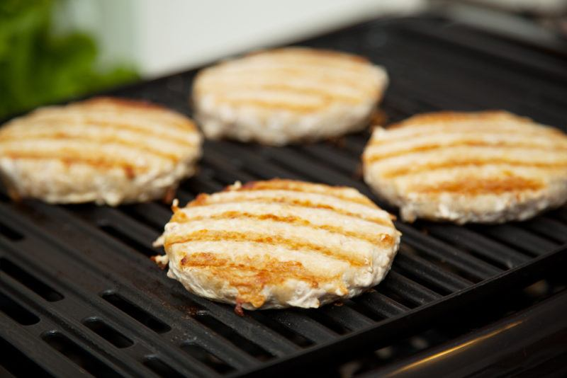 lean chicken burgers being grilled on fat reducing grill