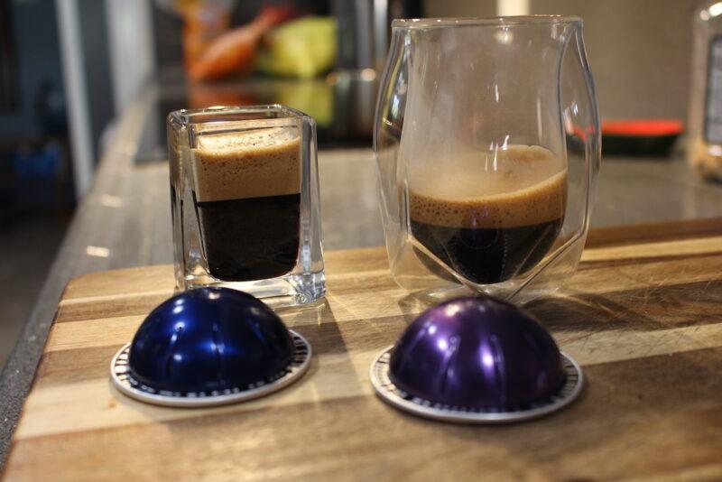 nespresso espresso pods in two types of glass coffee cups