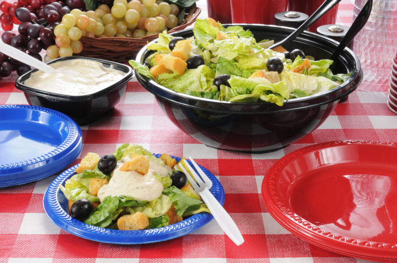 Fresh salad with lettuce, olives and croutons with a mayonnaise dressing.