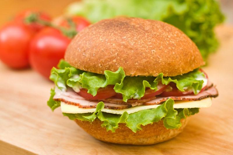 Smoked ham, lettuce and tomato sandwich.