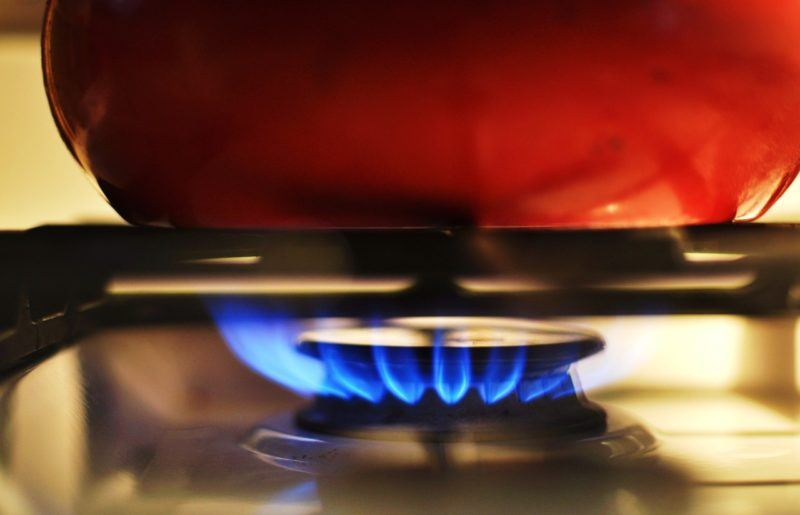 a close up of a gas stove heater to represent propane delivery services