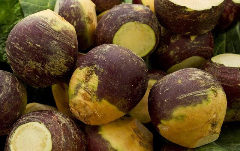 a closeup image of a pile of Rutabaga