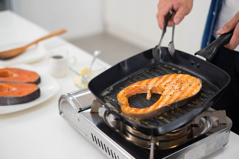 salmon cooking on small indoor grill