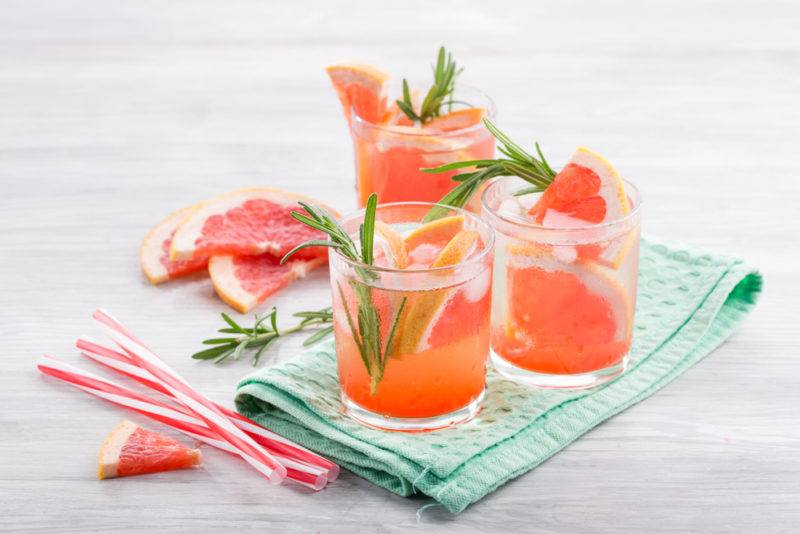 Three small gin and tonics with grapefruit juice