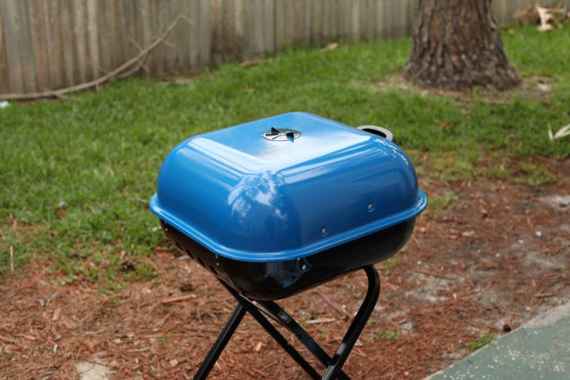 small blue backyard charcoal grill