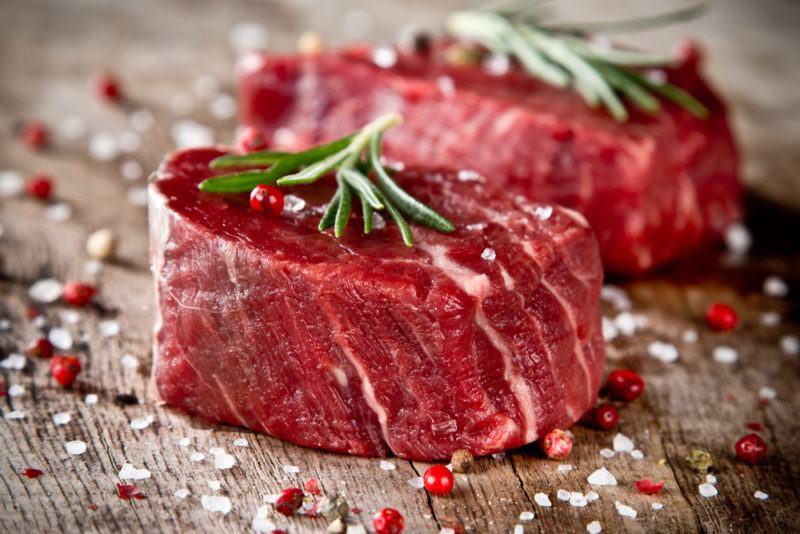 tenderloin steak raw with rosemary, salt, and peppercorns